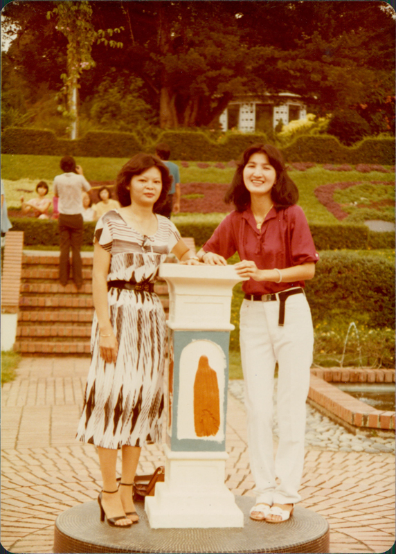 Wei Keong inherited his mother's smile. Here she is posing with a friend for a photo by the sundial at the Botanical Gardens. Photo: Tan Wei Keong