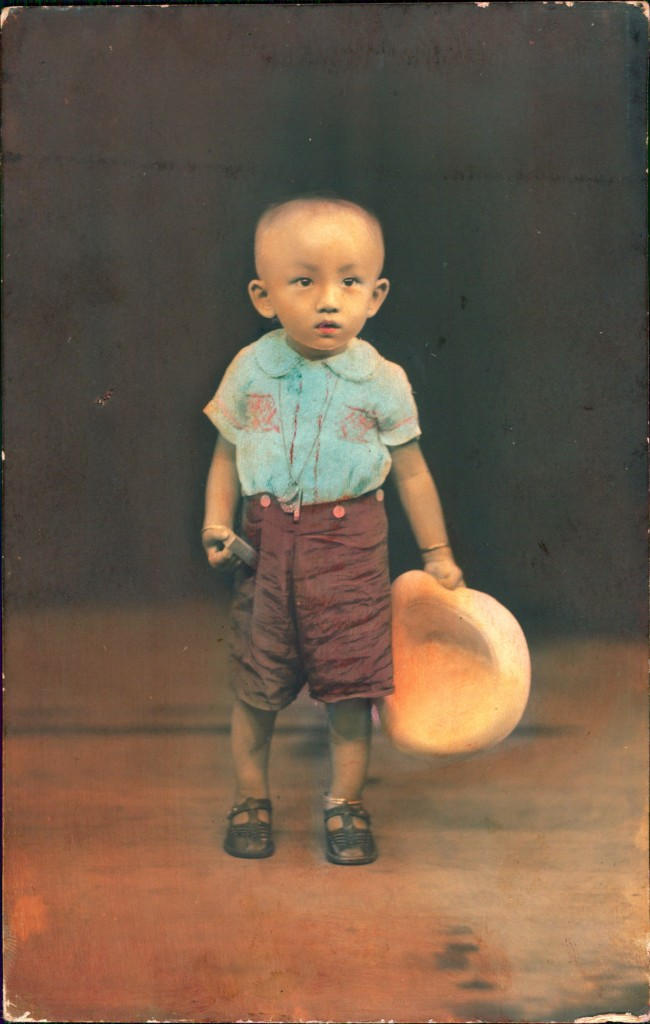 Hand-colored photograph of a boy. Photo: Wong Meng
