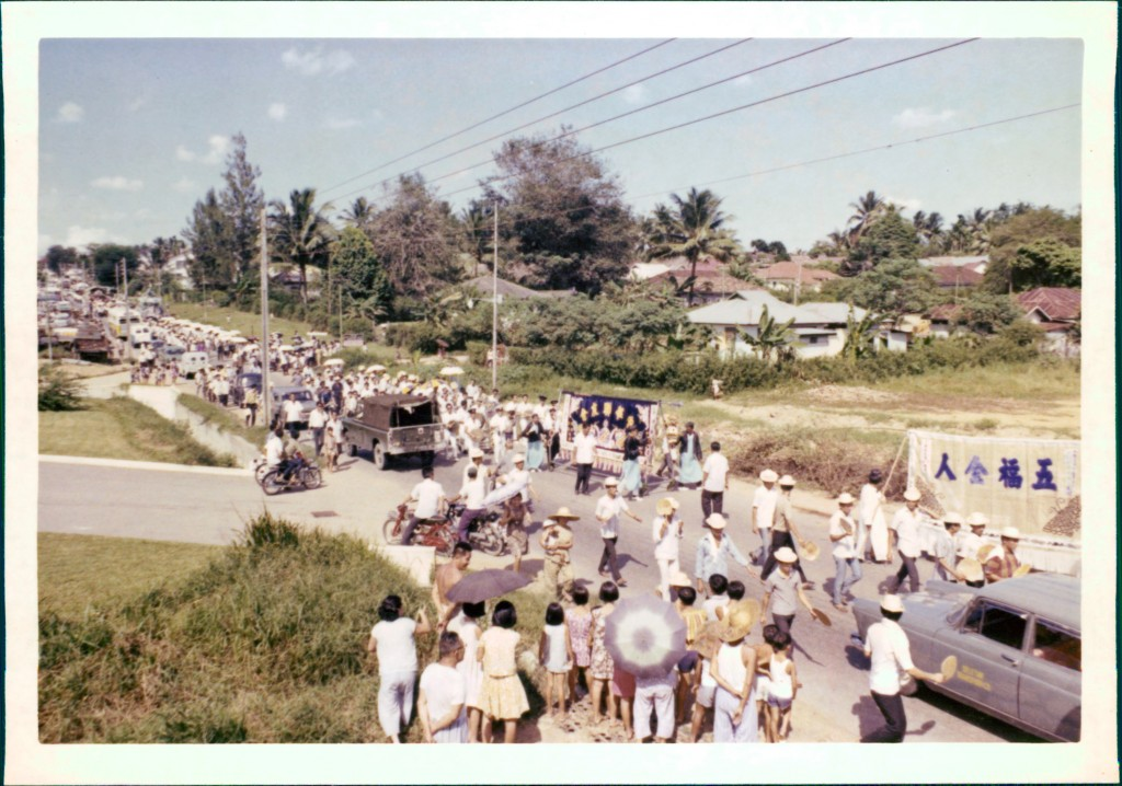 Funeral procession through the village, as curious bystanders look on. Photo: Teo Yap Tee