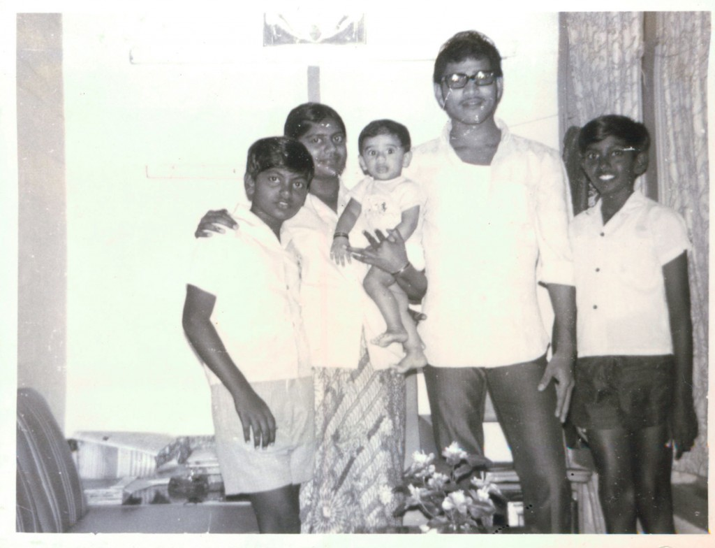 A photograph of Mdm Saraswathi, her husband, first son and her two brother in her husband's quarters. Photo credit: Mdm Saraswathi