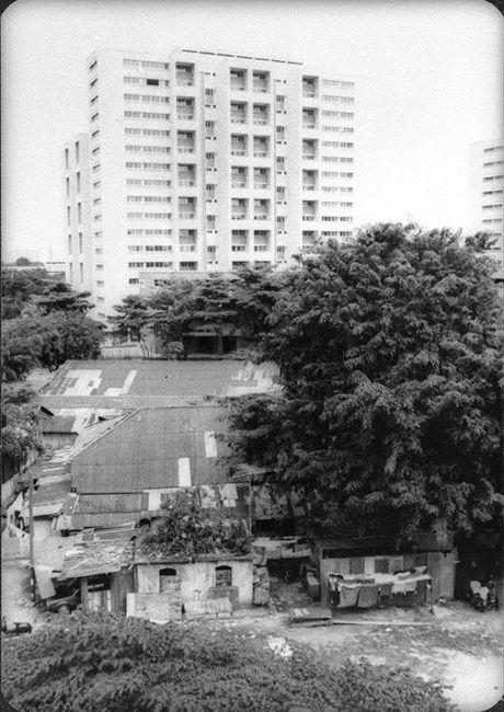 The neighborhood of Geylang Serai had kampong squatters located side by side HDB Flats in the before the 1990s. Photo credit: National Archives of Singapore