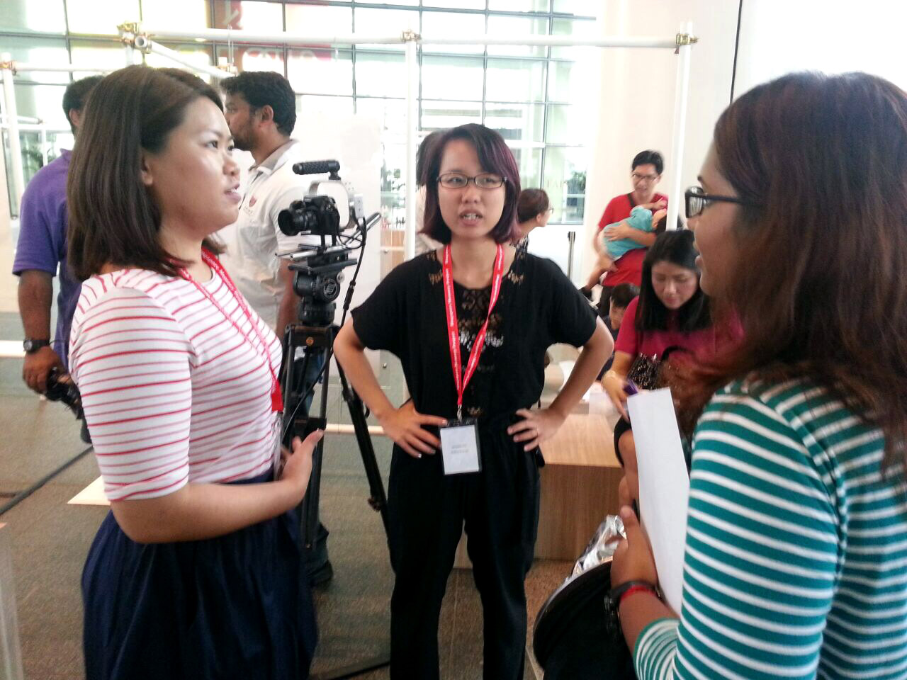 Gracie Teo (left) and Samantha Tio answer questions about Singapore Snaps